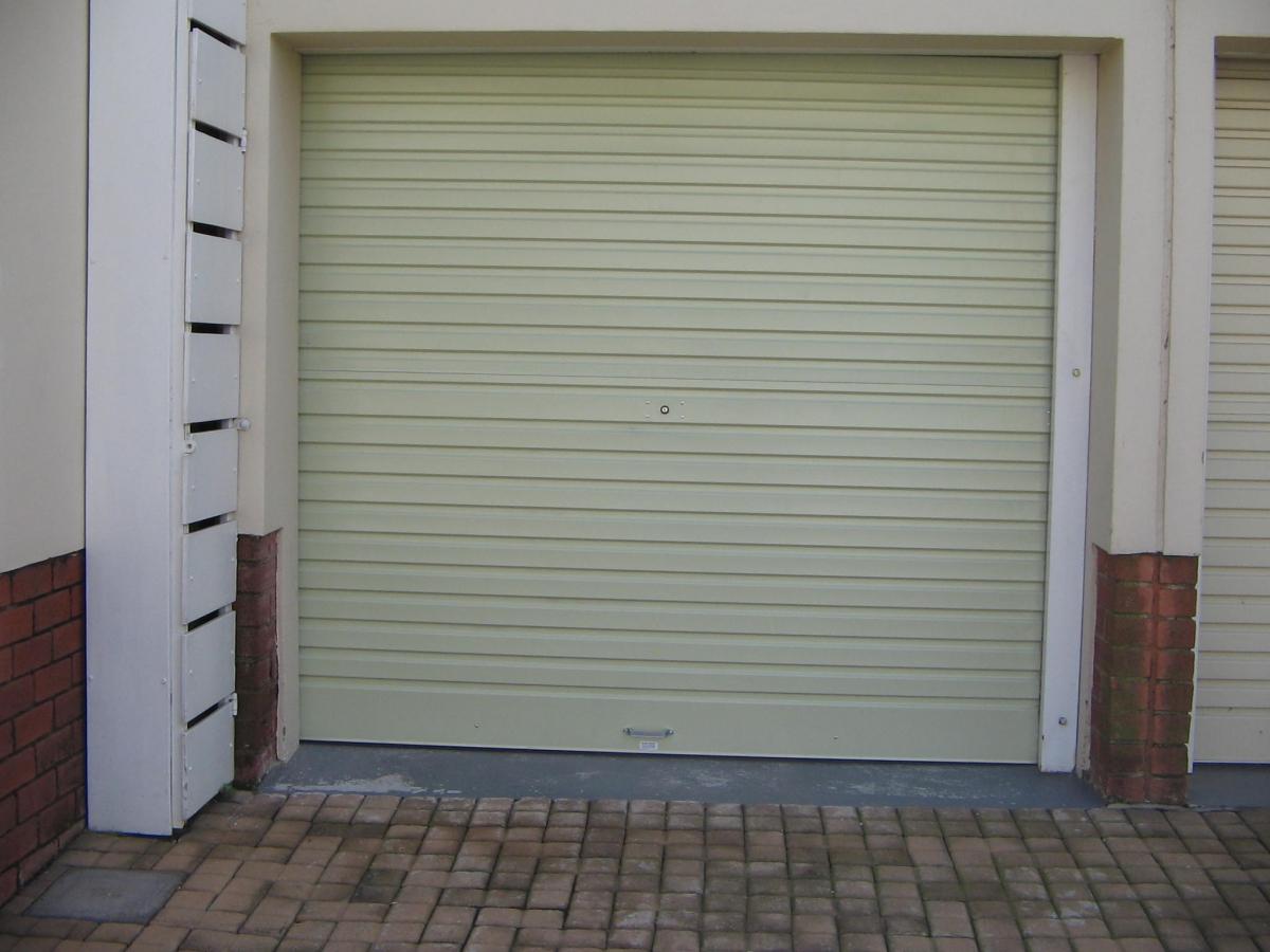 Garage doors delarey welding for Roll up garage door motors